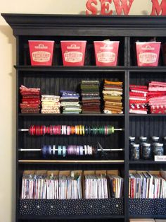 Great idea to use tension curtain rod inside a bookcase to hang ribbon.