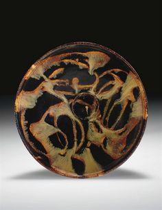 A rare Jizhou splashed black-glazed bowl , Southern Song Dynasty (1127-1279). Photo Christie's Image Ltd 2008 Potted with rounded flaring...