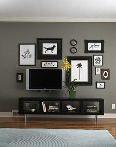 Living room by Anix. Clever way to group frames and flat screen TV.