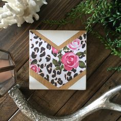 5.5x6wood chevron mixed media sign. White hand painted chevron (no tape or stencils) with roses and leopard print paper. Comes with hanging