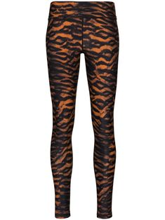 The Upside's leggings aren't for wallflowers, so if you want to make an entrance in the gym, they're just what you need. Snap them up to earn your (tiger) stripes. Get your sweat on. Featuring a high-rise waist and a tiger-print. Yoga Leggings, Black Leggings, The Upside, Tiger Stripes, Tiger Print, Gym, Entrance, Pants, Clothes