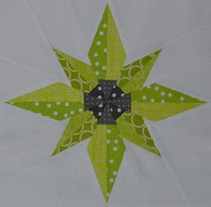 This is the test block I made myself for this quarter of the 3x6 Bee.  I asked for blocks in lime green and grey with a white background.  The pattern is Betelgeuse.  It's a paper-pieced pattern from eQuiltPatterns.