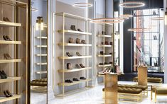 Simple yet luxurious shoe store design by Comelite Architecture Structure and Interior Design, white and taupe as the main color scheme, with accents of gold in the shoe racks, in stool legs and display tables, adding richness to the store's interior. Design Shop, Shoe Store Design, Shoe Shop, Showroom Interior Design, Luxury Interior, Luxury Store, Store Interiors, Modern Shop, Boutique