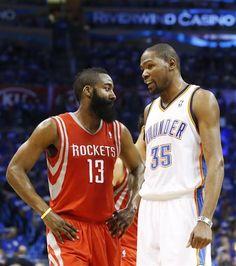 Houston Rockets guard James Harden (13) talks with Oklahoma City Thunder forward Kevin Durant (35)