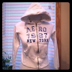 White and blue Aeropostale zip up! Size XS. blue lettering with white on the inside. No stains or holes. no strings.  Great condition! Aeropostale Other