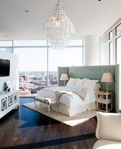 Loft style. Love the paded room divider as a headboard