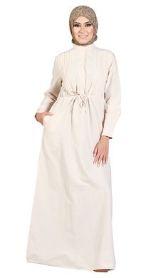 This exquisite Chambray fabric Abaya with stand collar, pin tucks, buttoned neck, and a drawstring waist is a perfect dream for the summer season. Combining the elegance of Chambray with the comfort of cotton this will be your summer favorite. Ideal for Ramadan & Hajj! Fabric: 100% Cotton.