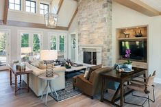 A shingle style family home was designed by Scott Christopher Homes along with J. Visser Design and Francesca Owings, sited in East Grand Rapids, Michigan. Home Living Room, Interior Design Living Room, Living Room Designs, Living Area, Fireplace Built Ins, Fireplace Wall, Fireplace Remodel, Fireplace Ideas, Stone Fireplace Designs