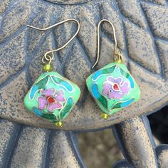 Vintage cloisonné lime & lavender flower earrings Vintage cloisonné lime & lavender colored flower earrings. Delicate and pretty! Double sided. One side of one earrings appears to have the red middle of the flower worn away or it's just an inconsistency in the initial coloring process. Fun and feminine  Vintage Jewelry Earrings