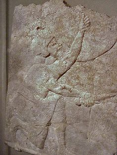 This relief from King Ashurbanipal's palace at Nineveh shows an Assyrian soldier kneeling next to a besieged Elamite city wall.Holding his round shield over him protection,he scrapes at the mud-brick fortication with his dagger in order to weaken the structure.During Ashurbanipal's reing in the final years of Assyria's military glory,large-scales siege scenes covered the palace walls...