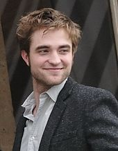 Robert Douglas Thomas Pattinson[3] (born 13 May 1986)[4] is an English actor, model, musician, and producer.[5] Born and raised in London, Pattinson started out his career by playing the role of Cedric Diggory in Harry Potter and the Goblet of Fire.[6] Later, he landed the leading role of Edward Cullen in the film adaptations of the Twilight novels by Stephenie Meyer, and came to worldwide fame,[7][8] thus establishing himself among the highest paid and most bankable actors in Hollywood