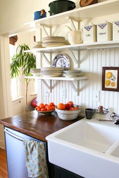 cute kitchen. white beat board, white cabinets, color paint on top