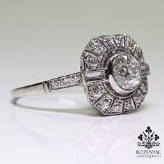 Period: Art deco (1920-1935) Composition: Platinum Stones: 1 Old mine cut diamond of H-VS2 quality that weighs 0.83ctw. 18 Old mine cut diamonds of H-VS2 qualit