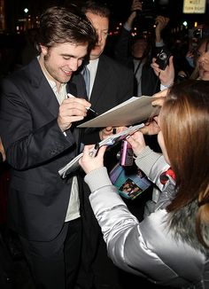 Robert Pattinson signing charity auction items Charity Fundraising Packages by Charity Fundraising Packages www.charityfundra...