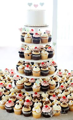 Cupcake wedding cake - but have cupcakes have one or two different designs.