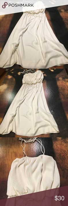 MONTGOMERY WARD White Dress Montgomery Ward creamy mini pleated dress. Like new, but likely vintage.  Going with large though size not in dress. See photos for measurements and feel free to ask any questions. Montgomery Ward Dresses