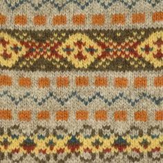 "Jamieson's ""The Duke"" Fair Isle v-neck sweater, greige, orange, brown and blue."