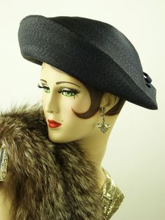Schiaparelli blue straw high front hat with cut out and bow trim to back & hat pin
