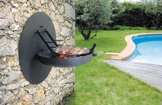 Sigmafocus folding wall mounted outdoor barbecue. Dome folds up and grill is out of sight. With several practical cooking positions, it is easily fixable on any wall (two anchors).