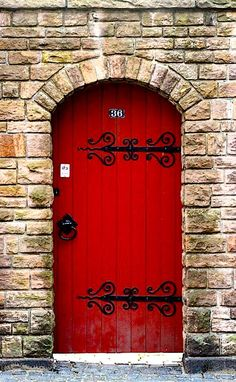 Red door in stone. And those hinges!!!
