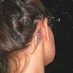 Behind the ear tattoo. Angel wing tattoo.