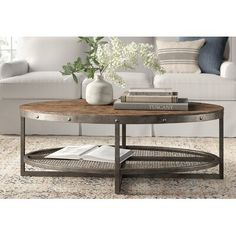 This coffee table is the perfect modern industrial update to any living room. Rub your hands over the solid pine top to feel the natural beauty of the wood, combined with a heavy metal frame and accented with a lower wire mesh shelf for storage. Unique Coffee Table, Coffee Table Styling, Rustic Coffee Tables, Diy Coffee Table, Decorating Coffee Tables, Coffee Table Design, Round Wood Coffee Table, Coffee Table Decor Living Room, Industrial Style Coffee Table