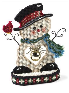Jingle Bell Snowman    Technique - Plastic Canvas  This festive fellow has a holiday heart larger than life. This e-pattern was originally published in Christmas Traditions in Plastic Canvas.