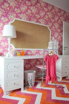 Cute desk/make up table. Looks like 2 end tables with a top made.  Also love the huge mirror over top!
