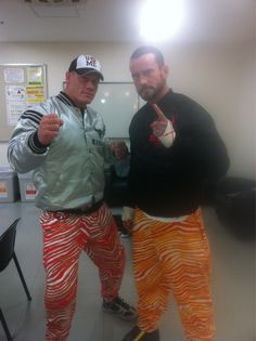@JohnCena & @CM_Punk uh....i want an story to this picture! LOL! those pants r from the 90's! LOL! love it!
