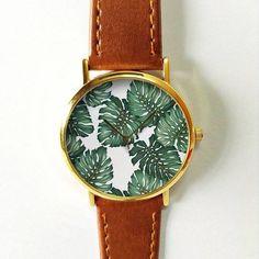 Tropische Palm bladeren Watch, palmtak, mannen horloge, Womens Watch, tropische planten, accessoires, sieraden, Palm Print, tropische blad, bruiloft Schepen wereldwijd Type: Quartz De grootte van de pols: 16.75 cm verstelbaar tot 20.75 cm (6,59 inch naar 8.16 inches) Display: analoog Bellen venster materiaal: glas Materiaal: metaal Case Diameter: 3,9 cm (1.53 inch) De dikte van het geval: 0.7 cm (0,27 inch) Band materiaal: PU leer Bandbreedte: 1.9 cm (0.74 inch) De lengte van de band: 22.75…