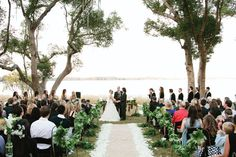 Jesse + Robb said 'I Do' in the Orlando neighborhood they grew up in. Turning a simple space into a romantic water-front ceremony. Photo by Kent Bristol Photography