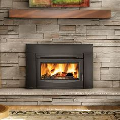 Wood burning fireplace inserts make an old fireplace new again! Shop custom, new, or replacement fireplace inserts from the Experts in Fire today. Shiplap Fireplace, Small Fireplace, Stove Fireplace, Fireplace Remodel, Fireplace Ideas, Fireplace Design, Fireplace Refacing, Cottage Fireplace, Fireplace Update