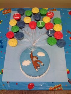 Curious George flying with balloons cake