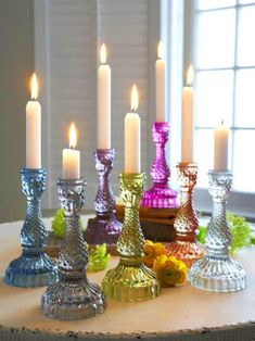 Obsessed :: jewel-tone glassware candlestick holders!! Such a fun centerpiece for a dinner party or summer soiree.