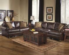 Brown leather sofa set for living room with dark hardwood floors ...