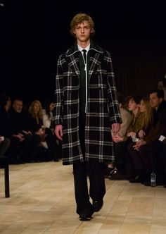 Wool and merino topcoat in black and white check with wide-leg trousers and The Sneakers