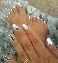 As seen on the Morning Show. Jamberry Metalic Chrome Silver with the mirror shine that made them famous. Stunning nails! I got mine on this website dalmationdots.jamberry.com