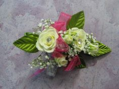white rose corsage with pink ribbon and bling