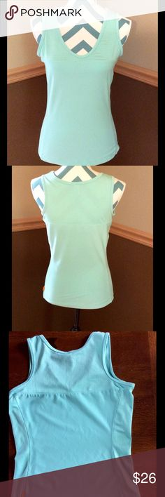Lucy workout tank.  Cute women's Lucy tank in size medium (long). Tank is 88% microfiber polyester and 12% Lycra.  Pretty shade of light blue/green.  Super soft fabric.  Nice mesh inserts along top and sides for increased breathability.  Tanks measures 17 inches across the chest and 24 inches long.  Tank has been gently worn but is in great condition. Lucy Tops Tank Tops