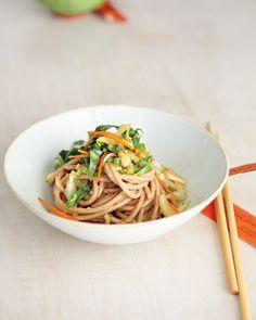 Cold Peanut Noodles   Martha Stewart Living - This vegan dish is an excellent combo of whole grains and plant-based protein while garlic, ginger, and soy sauce add flavor and a topping of bok choy and carrots provide a serving of vegetables.