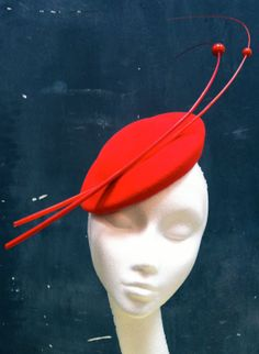 Hand made poppy red felt 'saturn' cocktail hat by fifilabellehats. Definitely one to make a statement in! www.fifilabelle.com