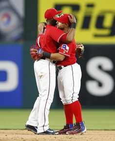 Texas Rangers shortstop Elvis Andrus, left, and second baseman Rougned Odor congratulate each other following their teams 8-4 win over the Baltimore Orioles during the seventh inning of a baseball game, Saturday, April 16, 2016, in Arlington, Texas. (AP Photo/Jim Cowsert)