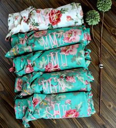 These are 100% cotton floral bridesmaid robes! Robes are a such practical bridesmaid gift because they can be worn on your wedding day, and over and over again! They could also be used for a bachelorette getaway or spa trip. They would look excellent personalized with your bridesmaids names in coral, mauve, or green thread. They would also look great flip-flopping thread colors; for example: embroider the white robe with sage, and the sage robes with white. These robes are one-size fits most…