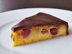 This elegant dessert marries three components: a moist olive oil cake made with cornmeal and flavored with orange, sweet olive oil-roasted grapes, and a thin coating of bittersweet chocolate ganache.