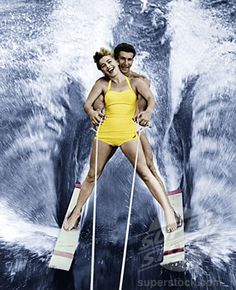 Portrait of a young couple waterskiing (255-2671A / 43596 © SuperStock)