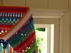 In my last post I left you with an unidentified pic as to what was on my hook as my next cheap and cheerful summer-living project. Well, here it is: A crochet fly-curtain! And just as the weather tur Crochet Curtain Pattern, Crochet Curtains, Beaded Curtains, Curtain Patterns, Fabric Strip Curtains, Fabric Strips, Diy Curtains, Valance, Crochet Home Decor