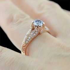 This engagement ring combo is drool worthy - rose gold with a blue diamond center stone.