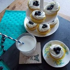 Lemon cupcakes topped with cream cheese frosting and fresh blueberries