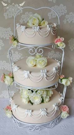 Romeo & Juliet Cakes, Doris 50s tiered wedding cake with pearls swags and bows, blush pink and white.