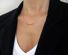 Curved Gold Bar Necklace / Gold Tube Necklace / Simple Gold Necklace. $27.00, via Etsy.